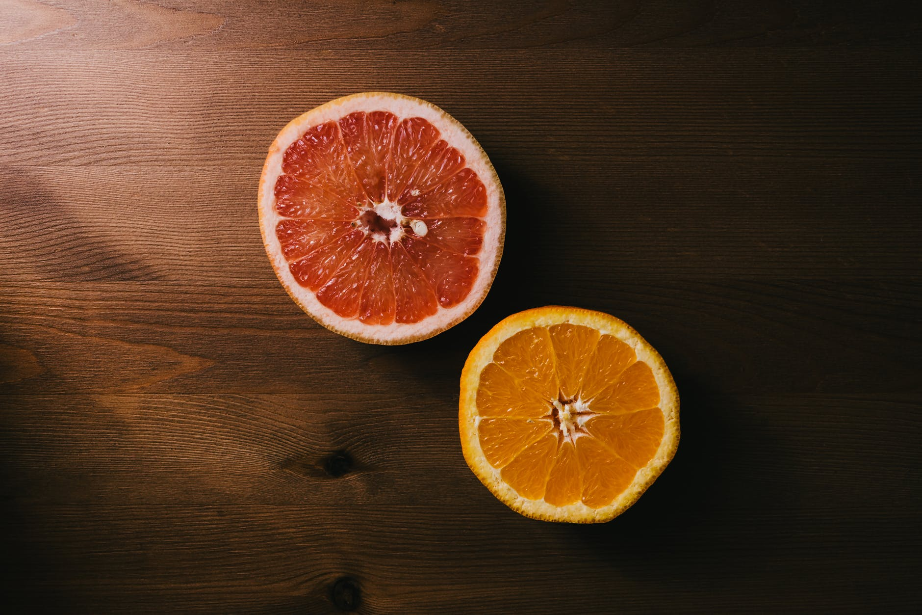 two sliced citrus fruits